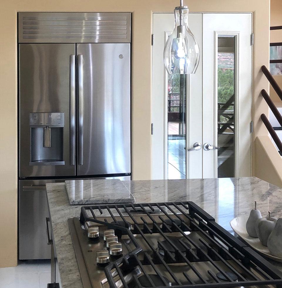 Micro Trim Inc. - Refrigerator with vent louver
